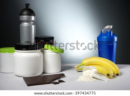 Sport Nutrition Supplement containers with shaker - stock photo