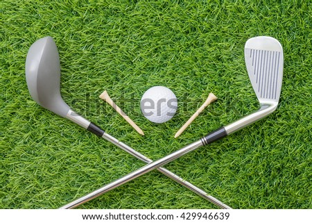 Sport objects related to golf equipment ,Golf club and ball on green grass