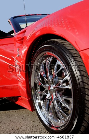 Sport red car with polished chrome trim. - stock photo