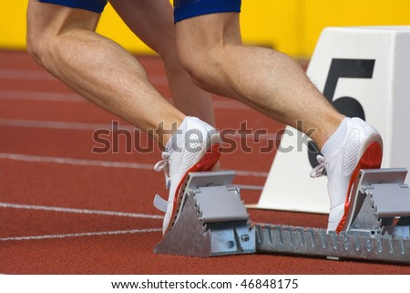 sport - runner at starting block in running competition - stock photo