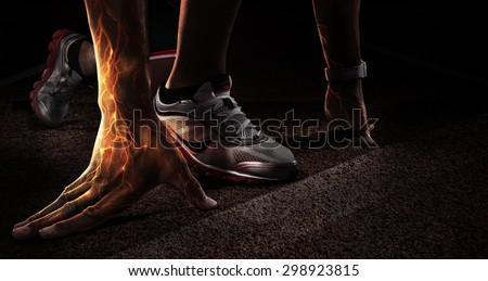 Sport. Runner. Hands on starting line. Power in the veins. Fire and energy - stock photo