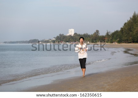 Sport - runner running and sprinting on beach . Athlete man during sprint run at great speed. Fitness man wearing relax clothes.  - stock photo