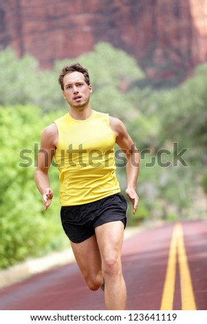 Sport - running fitness man sprinting training for marathon run. Fitness man with determination, concentration and strength training towards goals and success. - stock photo