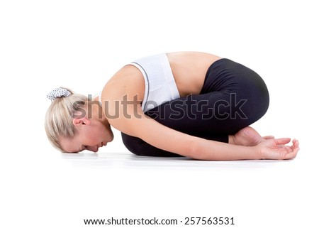 Sport Series: Young Blonde Woman doing Yoga . Childs Pose - stock photo