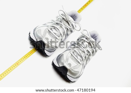 Sport shoes and centimeter as a fitness running - stock photo