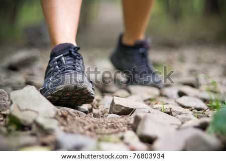 Sport shoes and exercise walking in summer, fitness concept. Jogging or training outside in summer nature, motivational health and inspirational idea. - stock photo