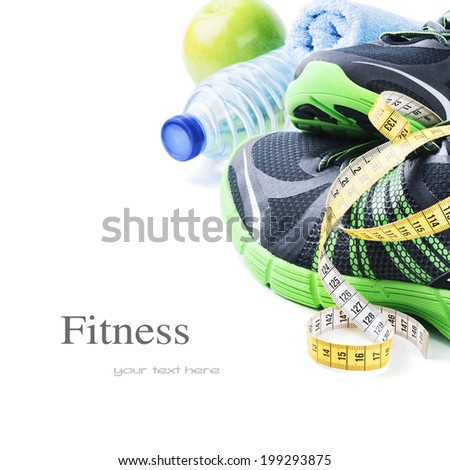Sport shoes and water bottle. Fitness concept - stock photo