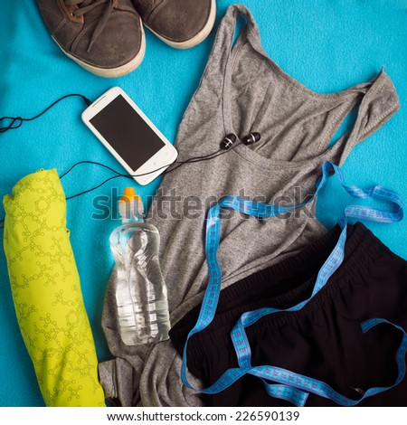 Sport shoes, measuring tape and water  - stock photo
