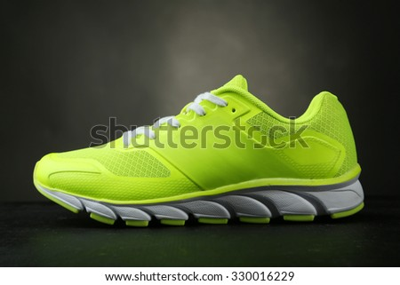 Sport shoes on black background - stock photo