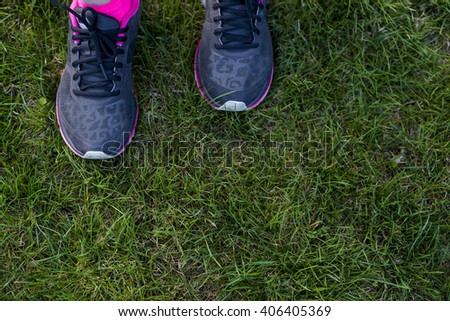 Sport shoes on green grass
