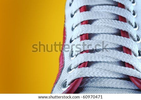 sport shoes  on orange background - stock photo