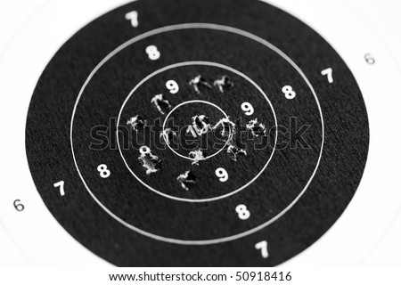 Sport shooting circle target accuracy bullet hole - stock photo