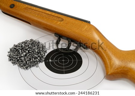 Sport shooting equipment on target. Air-gun and bullets. - stock photo