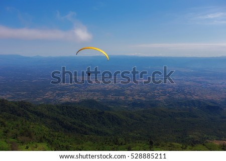 Sport skydiving and blue sky green mountains public landmark