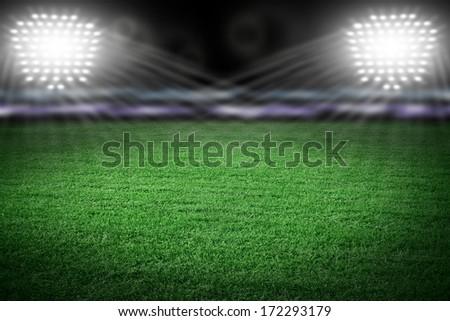 Sport stadium in night lights - stock photo