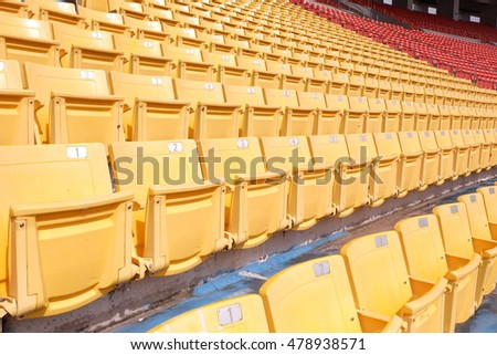 Sport stadium Plastic chairs in a football  stadium.
