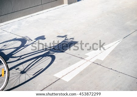 Sport style concept. Shadow of bicycle on the ground.