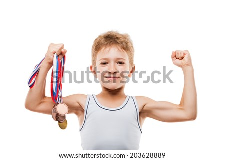 Sport success and win concept - smiling athlete champion child boy hand holding first place victory gold medal award - stock photo