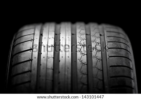 Sport summer tire isolated on black background