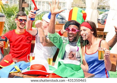 Sport supporters watching football game on tv screen at beach bar - Mixed race soccer fans cheers with beer together as best friends - Concept of fun and people friendship at sportive events -  - stock photo