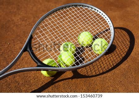 Sport, Tennis racket and balls - stock photo