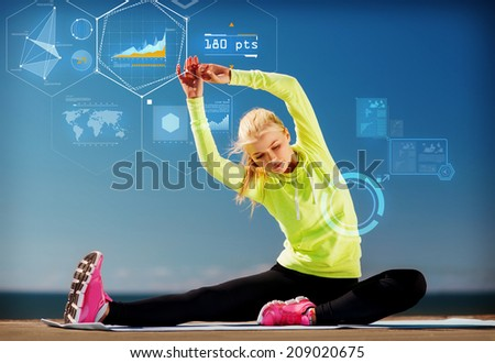 sport, training, technology and lifestyle concept - young woman exercising outdoors - stock photo