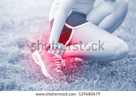 sport woman ankle injury in park, great for your design