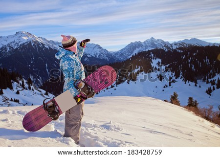 Sport woman in snowy mountains - stock photo