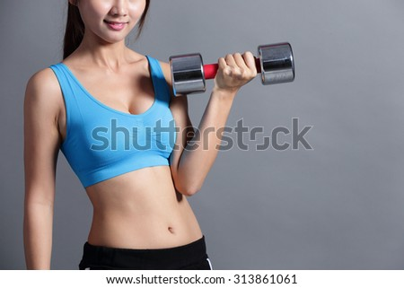 Sport woman is lifting weights isolated on the background, asian.