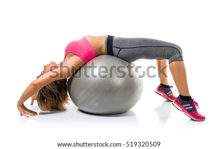 Sport woman making sport with fit ball stretching