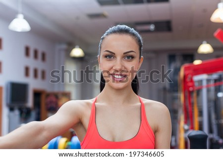 sport woman smile at camera self picture at gym, young girl picture herself exercising fitness center - stock photo