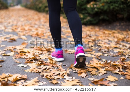 Sport woman training outside in city park. Autumn sport training outsite