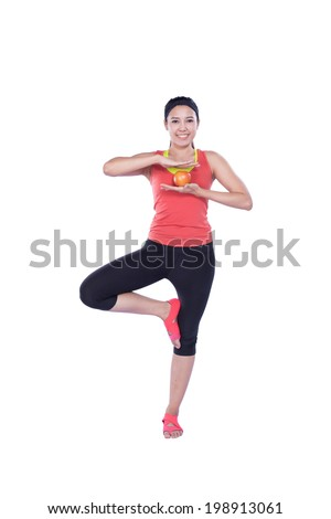 sport woman with apple isolated on white background