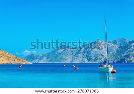 Sport yacht on anchor in silent bay on Greek Island, Greece - stock photo