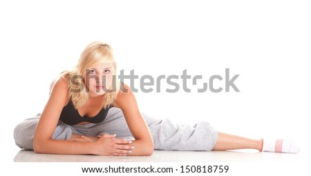 Sport Young woman in black doing exercise gymnastic pose isolated on white - stock photo