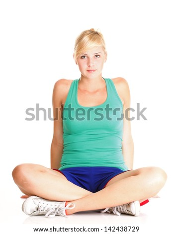 Sport Young woman in green doing exercise gymnastic pose isolated on white - stock photo