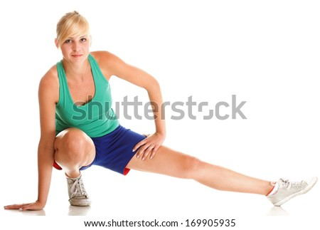 Sport Young woman in green doing exercise gymnastic pose isolated on white