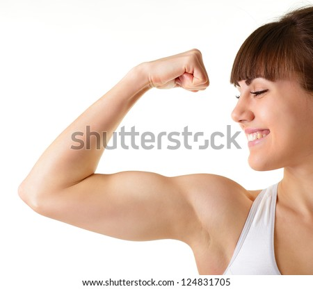 sport young woman with perfect body showing biceps, fitness girl studio shot over white background - stock photo