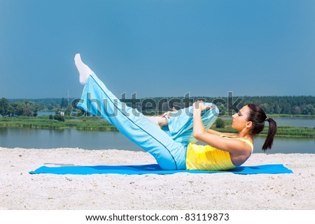 Sporting a young girl has pilates - stock photo
