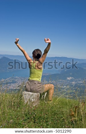 sporting woman making of the stretchings in nature - stock photo
