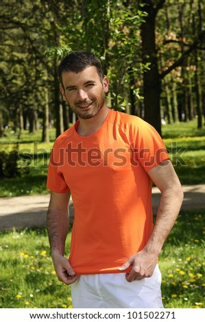 sportive and cheerful man in a natural background