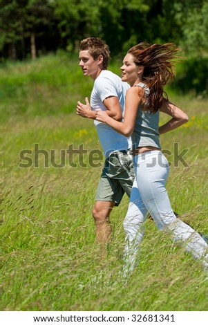 Sportive couple jogging in the nature, shallow DOF