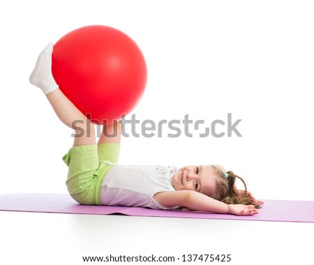 Sportive kid having fun with  gymnastic ball isolated - stock photo