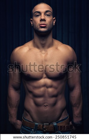 sportive man with a muscular body - stock photo