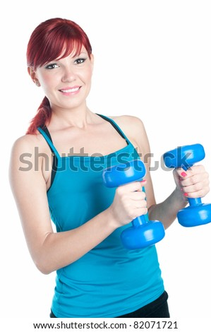 Sportive red-haired woman with dumbbells, isolated on white - stock photo