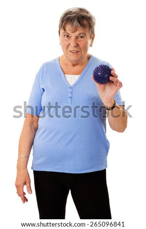 Sportive senior woman holding a massage ball - isolated - stock photo