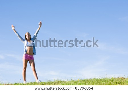 Sportive stretching young happy woman meadows blue summer sky - stock photo