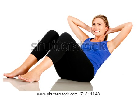 Sportive woman doing abdominals - isolated over white - stock photo