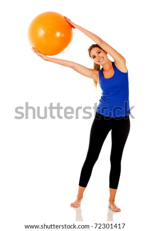 Sportive woman exercising with a pilates ball - isolated over white - stock photo