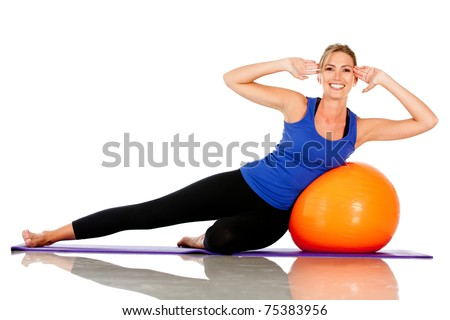 Sportive woman exercising with a Swiss ball - isolated - stock photo
